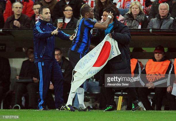 Samuel Eto'o of Inter Milan celebrates his first goal with his teammate Yuto Nagatomo holding a Japanese flag during the UEFA Champions League round...