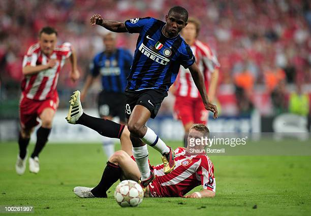 Samuel Eto'o of Inter Milan is challenged by Bastian Schweinsteiger of Bayern Muenchen during the UEFA Champions League Final match between FC Bayern...