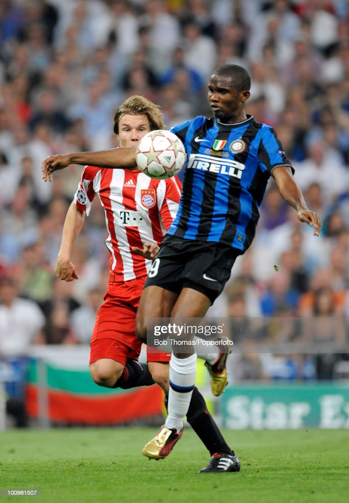 Samuel Eto'o of Inter Milan watched by Holger Badstuber of Bayern Munich during the UEFA Champions League Final match between Bayern Munich and Inter Milan at the Estadio Santiago Bernabeu on May 22, 2010 in Madrid, Spain.