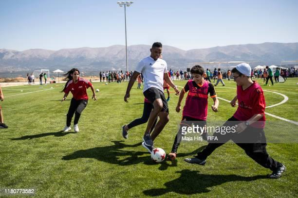 Samuel Eto'o plays football with children in Mount Lebanon in Lebanon on October 13 2019 FIFA President Gianni Infantino alongside FIFA Legends Kaka...