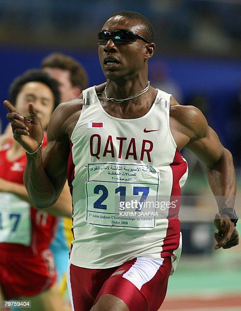 Samuel Francis of Qatar leads in the 60m competition during the Asian athletics indoor games at the Aspire Academy of Sports in the Qatari capital...