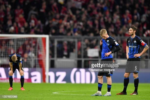 Samuel Fridjonsson and Christian Strohdiek of SC Paderborn react after the Bundesliga match between FC Bayern Muenchen and SC Paderborn 07 at Allianz...