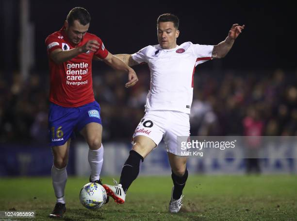 Samuel Gallaway of Bonnyrigg White Eagles FC competes for the ball against Alexander Baumjohann of the Wanderers during the FFA Cup round of 16 match...