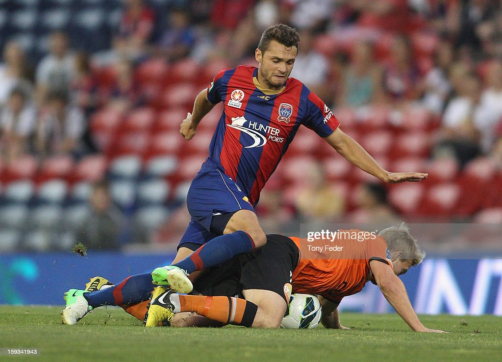 Samuel Galloway of the Jets contests the ball with Ben Halloran of the Roar during the round 16 A-League match between the Newcastle Jets and the Brisbane Roar at Hunter Stadium on January 12, 2013 in Newcastle, Australia.