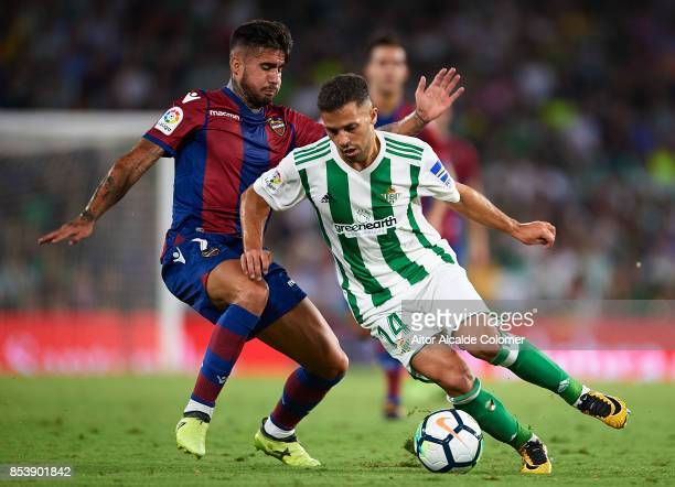 Samuel Garcia of Levante UD competes for the ball with Arnaldo Antonio Sanabria of Real Betis Balompie during the La Liga match between Real Betis...