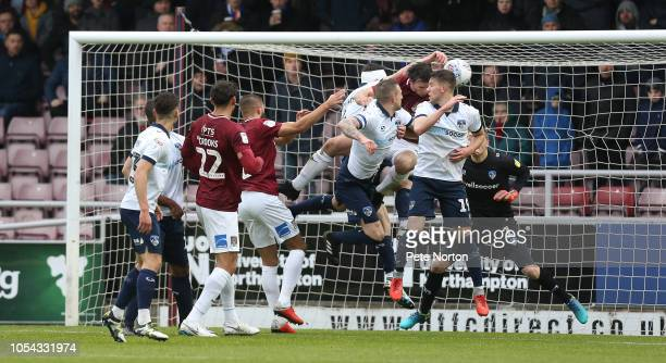 Samuel George Edmundson of Oldham Athletic handles the ball to conseed a penalty during the Sky Bet League Two match between Northampton Town and...