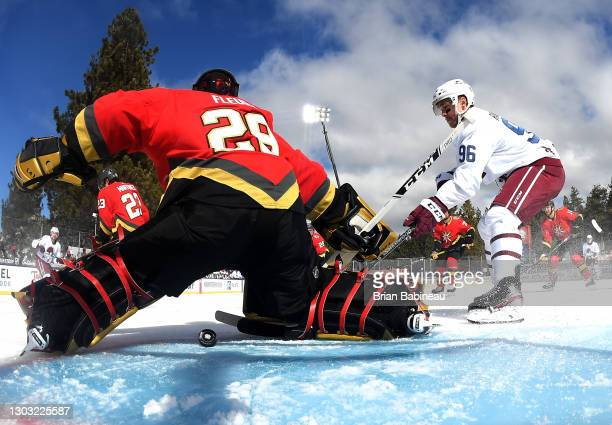 Samuel Girard and Mikko Rantanen of the Colorado Avalanche watch as the puck gets past goaltender Marc-Andre Fleury of the Vegas Golden Knights to...