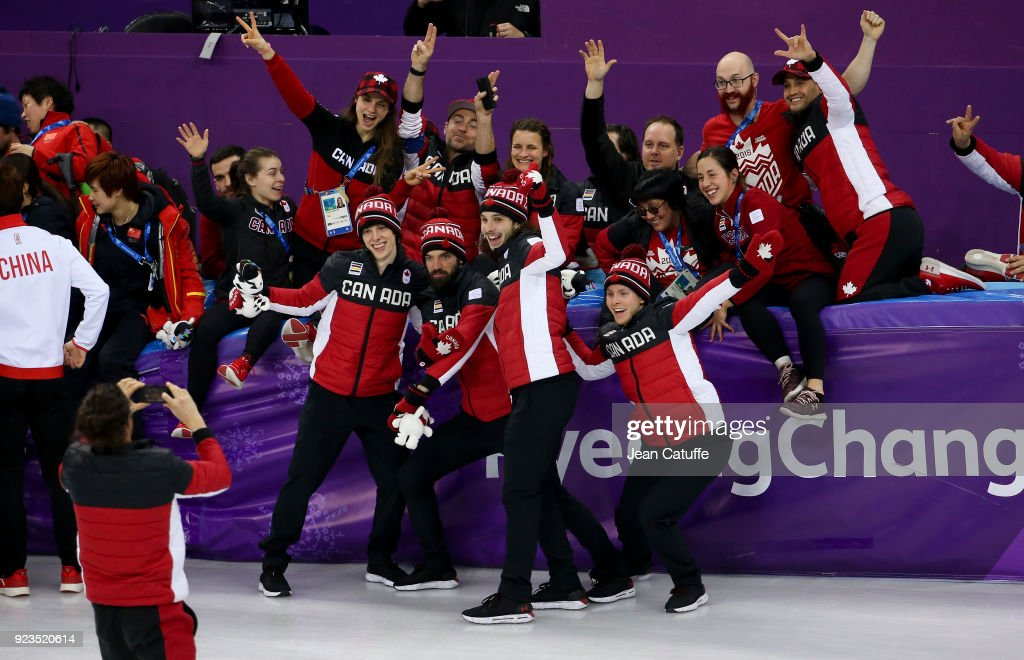 Samuel Girard, Charles Hamelin, Charle Cournoyer and Pascal Dion of Canada celebrate their third place with staff following the Short Track Speed Skating Men's 5000m Relay Final A on day thirteen of the PyeongChang 2018 Winter Olympic Games at Gangneung Ice Arena on February 22, 2018 in Gangneung, South Korea.