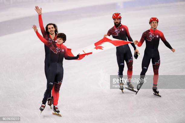 Samuel Girard Charles Hamelin Charlie Cournoyer and Pascal Dion of Canada celebrate winning the bronze medal during the Men's 5000m Relay Final A on...