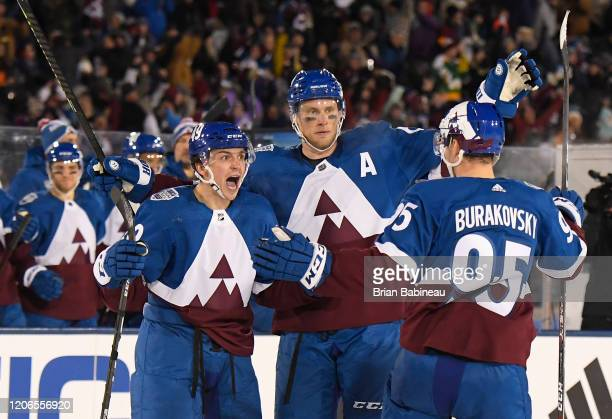 Samuel Girard, Erik Johnson and Andre Burakovsky of the Colorado Avalanche celebrate Girard's goal during the second period of the 2020 NHL Stadium...