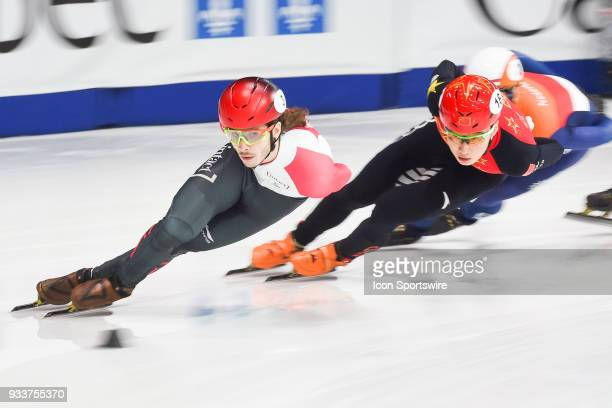 Samuel Girard leads the race Ziwei Ren during the 1000m Semifinals at ISU World Short Track Speed Skating Championships on March 18 at MauriceRichard...
