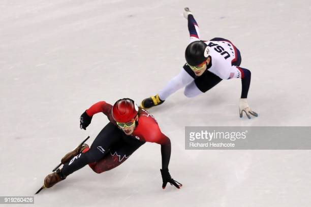 Samuel Girard of Canada and JohnHenry Krueger of the United States compete during the Short Track Speed Skating Men's 1000m Final A on day eight of...