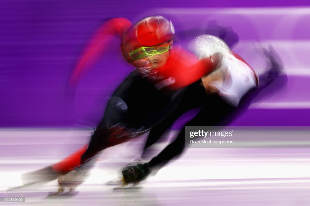 Samuel Girard of Canada and Roberts Zvejnieks of Latvia compete during the Men's Short Track Speed Skating 500m Heats on day eleven of the PyeongChang 2018 Winter Olympic Games at Gangneung Ice Arena on February 20, 2018 in Gangneung, South Korea.