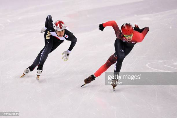 Samuel Girard of Canada and Ryosuke Sakazume of Japan skate during their Men's 500m Short Track Speed Skating Quarter Final on day thirteen of the...