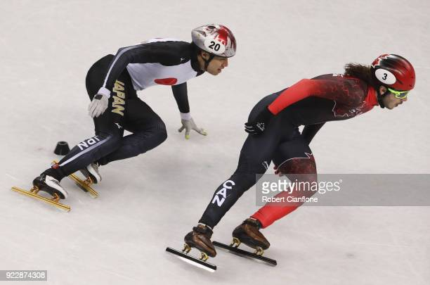 Samuel Girard of Canada and Ryosuke Sakazume of Japan skate during their Men's 500m Short Track Speed Skating Quarter Final on day thirteen of the...
