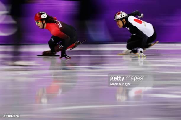 Samuel Girard of Canada and Ryosuke Sakazume of Japan skate in their Men's 500m Short Track Speed Skating Quarter Final on day thirteen of the...