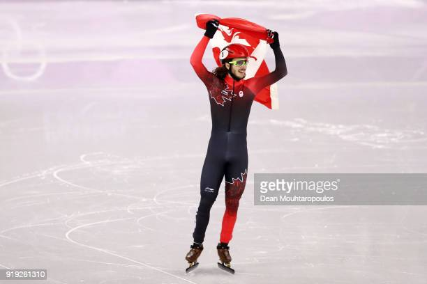 Samuel Girard of Canada celebrates after winning the gold medal during the Short Track Speed Skating Men's 1000m Final A on day eight of the...