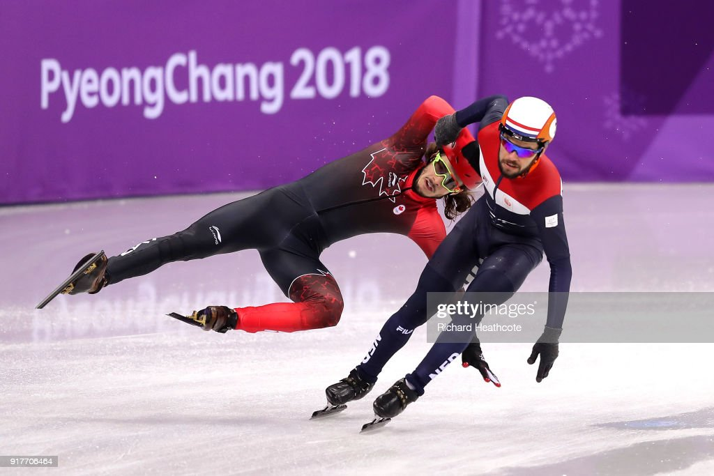 Samuel Girard of Canada crashes near Sjinkie Knegt of the Netherlands during the Men's 5000m Relay Short Track Speed Skating heat 1 on day four of the PyeongChang 2018 Winter Olympic Games at Gangneung Ice Arena on February 13, 2018 in Gangneung, South Korea.
