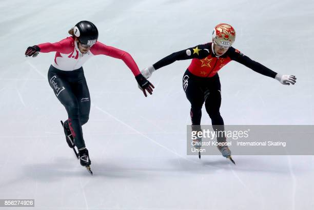 Samuel Girard of Canada crosses the finis before Han Tianyu of China during the men 5000m relay final A of the Audi ISU World Cup Short Track Speed...