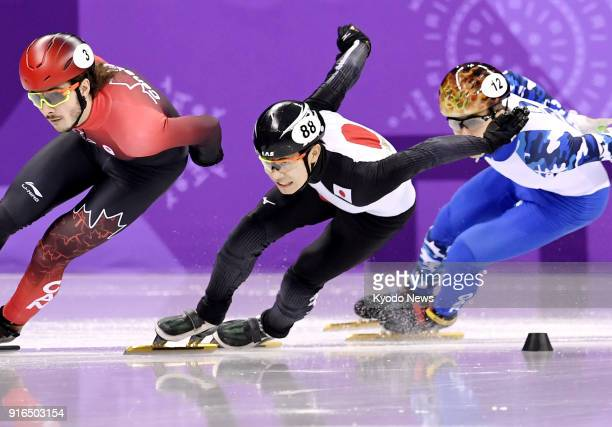 Samuel Girard of Canada Hiroki Yokoyama of Japan and Semen Elistratov of the Olympic Athletes of Russia compete in a heat of the men's 1500meter...