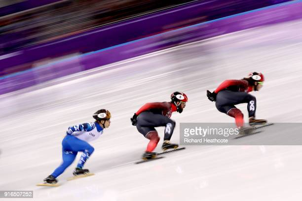 Samuel Girard of Canada leads Sjinkie Knegt of the Netherlands and Semen Elistratov of Olympic Athlete from Russia during the Men's 1500m Short Track...