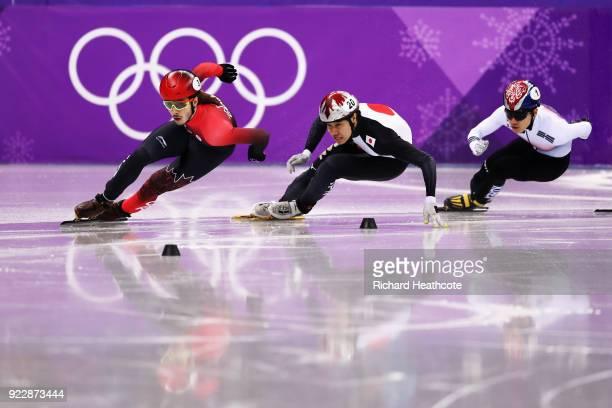 Samuel Girard of Canada Ryosuke Sakazume of Japan and Yira Seo of Korea skate during their Men's 500m Short Track Speed Skating Quarter Final on day...