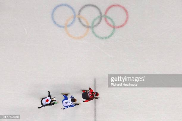 Samuel Girard of Canada Semen Elistratov of Olympic Athlete from Russia and Keita Watanabe of Japan compete during the Men's 1000m Short Track Speed...