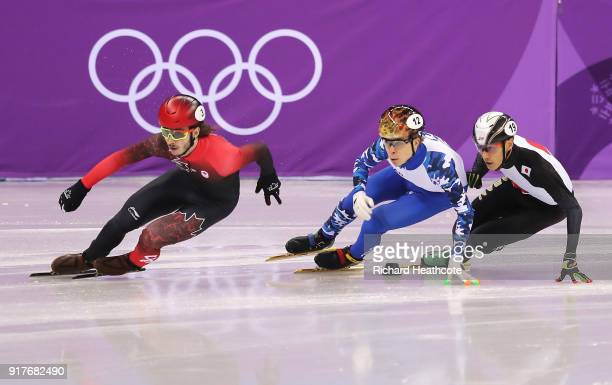 Samuel Girard of Canada Semen Elistratov of Olympic Athlete from Russia Keita Watanabe of Japan compete during the Men's 1000m Short Track Speed...