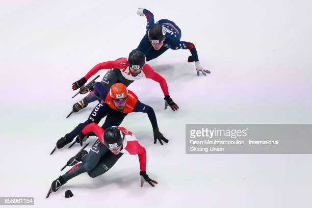 Samuel Girard of Canada Sjinkie Knegt of the Netherlands and Charles Hamelin of Canada compete in the Mens 1000m Semi Finals during the Audi ISU...