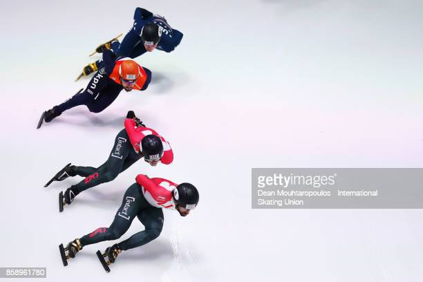 Samuel Girard of Canada Sjinkie Knegt of the Netherlands and Charles Hamelin of Canada lead the Mens 1000m Semi Finals during the Audi ISU World Cup...