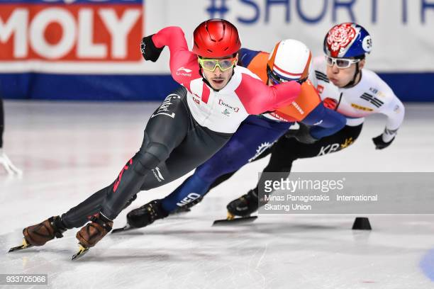 Samuel Girard of Canada takes the lead in the second heat of the men's 1000 meter semifinal during the World Short Track Speed Skating Championships...