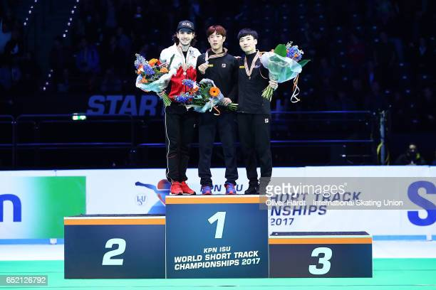 Samuel Girard of Canada with the silver medal Sin da Woon of Korea with the gold medal and Seo Yi Ra of Korea with the bronze medal celebrate after...