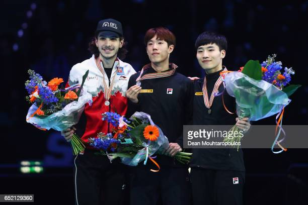 Samuel Girard of Canada with the silver medal Sin da Woon of Korea with the gold medal and Seo Yi Ra of Korea with the bronze medal celebrate on the...
