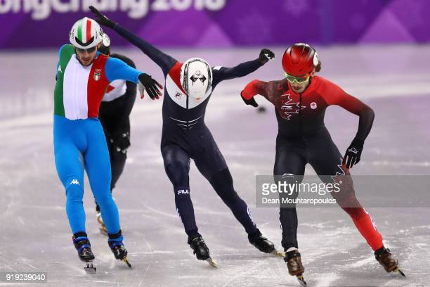 Samuel Girard of Canada Yuri Confortola of Italy Itzhak De Laat of the Netherlands and Kazuki Yoshinaga of Japan reach for the finish line during the...