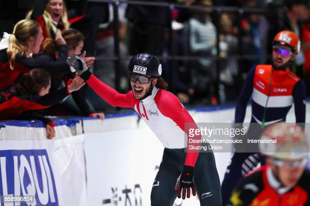 Samuel Girard of Team Canada with Pascal Dion Charle Cournoyer Francois Hamelin Charles Hamelin celebrate winning the Mens 5000m Relay Final Gold...