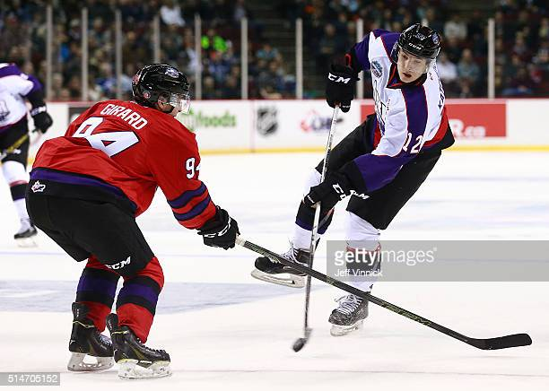 Samuel Girard of Team Cherry looks on as Boris Katchouk of Team Orr takes a shot during the CHL/NHL Top Prospects Game January 28 2016 at Pacific...