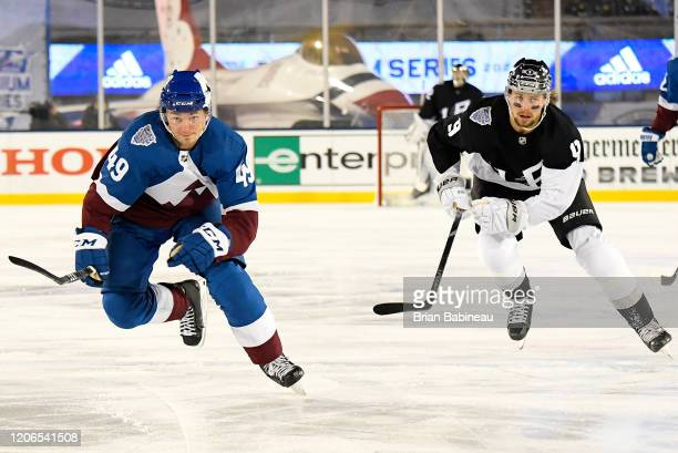 Samuel Girard of the Colorado Avalanche and Alex Iafallo of the Los Angeles Kings skate after the puck in the first period of the 2020 NHL Stadium...