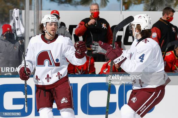 Samuel Girard of the Colorado Avalanche celebrates with Bowen Byram after scoring a first period goal against the Vegas Golden Knights during the...