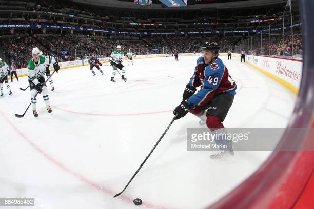 Samuel Girard of the Colorado Avalanche controls the puck against the Dallas Stars at the Pepsi Center on December 3 2017 in Denver Colorado