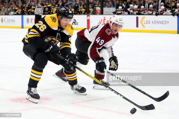 Samuel Girard of the Colorado Avalanche defends Par Lindholm of the Boston Bruins during the third period at TD Garden on December 07 2019 in Boston...