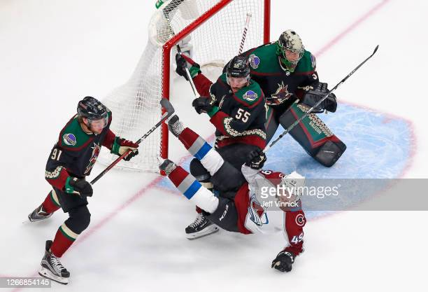 Samuel Girard of the Colorado Avalanche is tripped up by Jason Demers of the Arizona Coyotes during the first period in Game Four of the Western...
