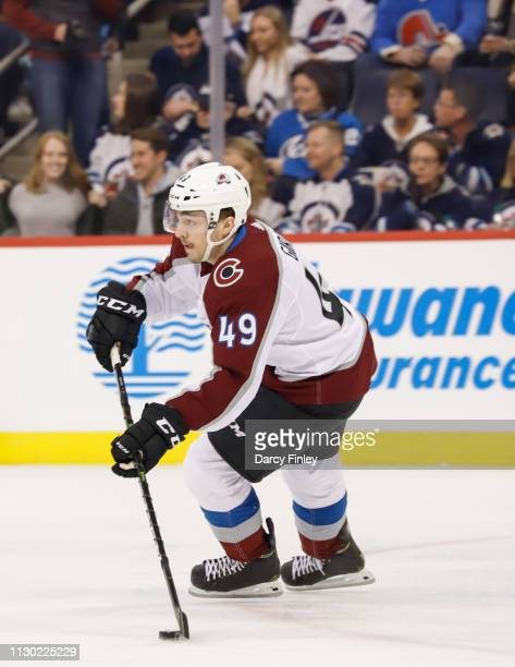 Samuel Girard of the Colorado Avalanche plays the puck up the ice during first period action against the Winnipeg Jets at the Bell MTS Place on...