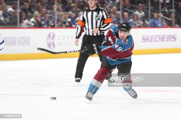 Samuel Girard of the Colorado Avalanche shoots against the Toronto Maple Leafs at Pepsi Center on November 23, 2019 in Denver, Colorado. The Maple...