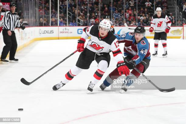 Samuel Girard of the Colorado Avalanche skates against Nico Hischier of the New Jersey Devils at the Pepsi Center on December 1 2017 in Denver...
