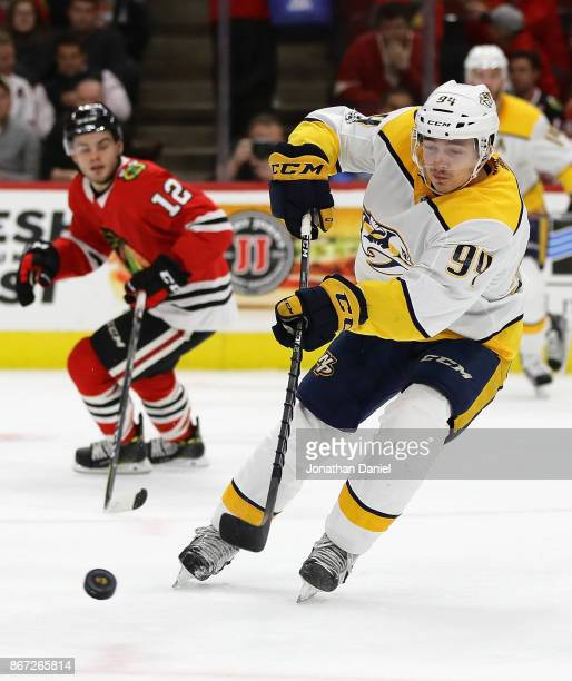 Samuel Girard of the Nashville Predators passes the puck against the Chicago Blackhawks at the United Center on October 27 2017 in Chicago Illinois