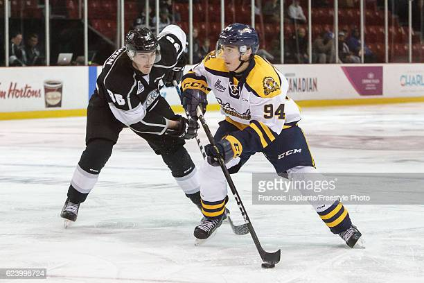 Samuel Girard of the Shawinigan Cataractes skates with the puck against Zack MacEwen of the Gatineau Olympiques on November 9 2016 at Robert Guertin...