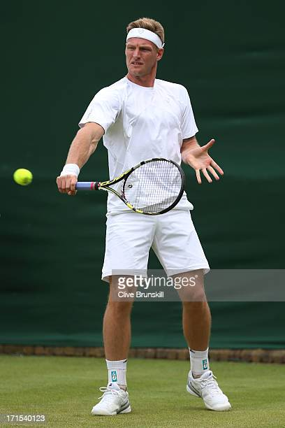 Samuel Groth of Australia plays a backhand during the Gentlemen's Doubles first round match between Samuel Groth and Chris Guccione of Australia and...