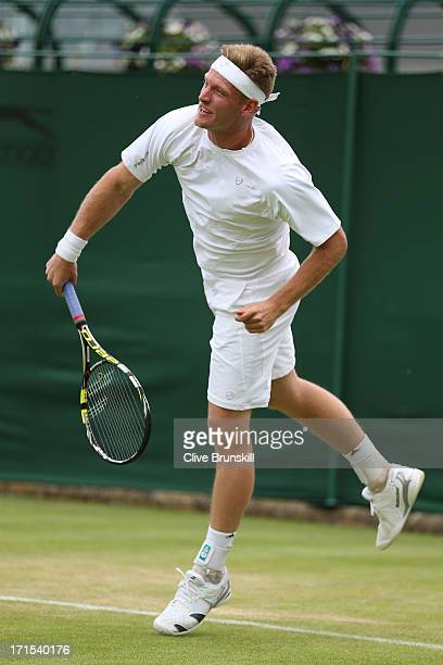 Samuel Groth of Australia serves during the Gentlemen's Doubles first round match between Samuel Groth and Chris Guccione of Australia and Steve...