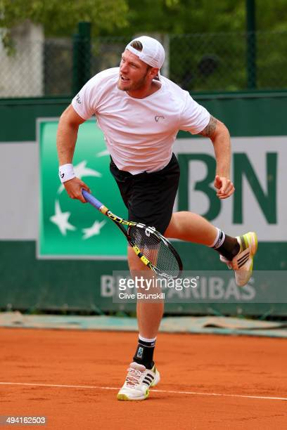 Samuel Groth of Australia serves next to his partner Andrey Golubev during his men's doubles match against Carlos Berlocq of Argentina and Daniele...