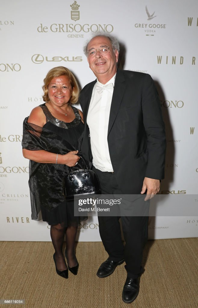 Samuel Hadida (R) and wife attend The Weinstein Company party in celebration of 'Wind River' in association with de Grisogono, Grey Goose Vodka, Hotel de Crillon, and Lexus at Nikki Beach on May 20, 2017 in Cannes, France.
